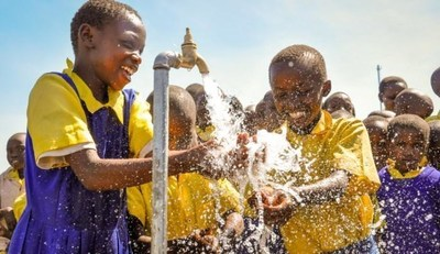 Children celebrate the arrival of clean drinking water at their school in a World Vision area development program in Wema, Kenya. PHOTO: World Vision