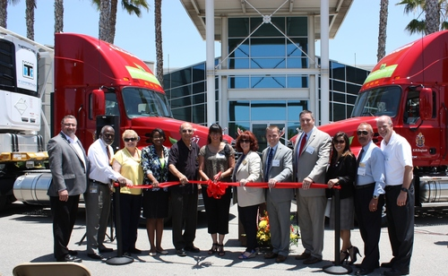 Representatives of C.R. England are joined by local city and area government officials at the opening of the ...