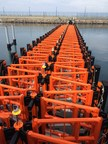 Collapsable, fully automated Marine Gate secures opening to Naval Base at push of a button.