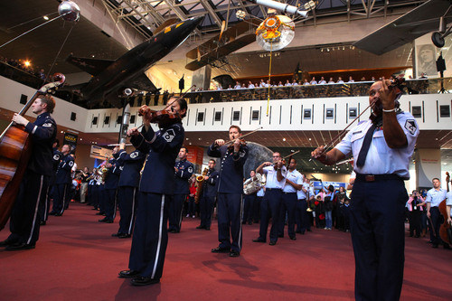 The USAF Band announced the beginning of their holiday concerts with a flash mob at the Smithsonian's National Air and Space Museum on December 3, 2013. (U.S. Air Force photo by Master Sgt. Tara Islas/released). (PRNewsFoto/Smithsonian's National Air and Space Museum) (PRNewsFoto/SMITHSONIAN'S NATIONAL AIR ...)