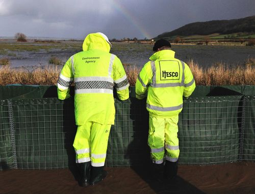 HESCO Engineer on site to aid the Environment Agency with the deployment of HESCO flood barriers. (PRNewsFoto/HESCO Bastion Ltd)