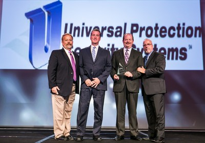 From left, the award presentation consisted of Larry Newman, Director of Sales-Axis Communications; Bob Hinton, Director of Corporate Accounts-Universal Protection Security Systems; Steve Pounds, Vice President and General Manager-Universal Protection Security Systems; and Scott Dunn, Director of Business Development-Axis Communications. (PRNewsFoto/Universal Protection Security...)