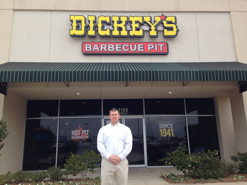 Owner Operator, Chris Durant in front of the new Dickey's Barbecue in Monroe, LA. (PRNewsFoto/Dickey's Barbecue) (PRNewsFoto/DICKEY'S BARBECUE)