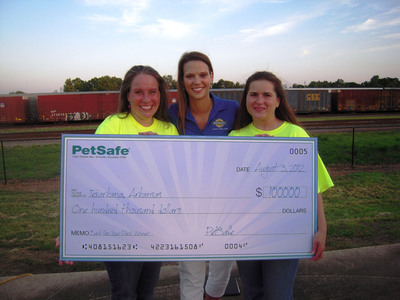 "On Aug. 3, 2012, PetSafe presents a $100,000 grand prize check to the city of Texarkana, Ark., the ""top dog"" in the 2012 ""Bark for Your Park"" contest. The prize money will be used to build the PetSafe Jef-FUR-son Dog Park, a local off-leash dog park in Texarkana. Robin Rhea (center) of PetSafe presents the check to Deanna O'Malley (left) and Crystal Sloan (right) of the Texarkana dog park committee."