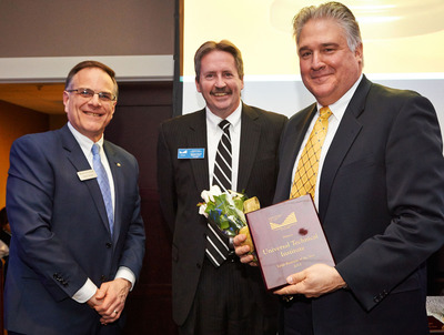 """Chuck Barresi (far right), President of the Norwood campus of Universal Technical Institute, accepts the Neponset Valley Chamber of Commerce """"Large Business of the Year"""" Award on behalf of the school during a ceremony at the NVCC annual awards meeting. Also Pictured are Chamber member Anthony Caruso, Senior Vice President at Bank of Canton, and Mike Moran, Executive Vice President at Dedham Savings and NVCC Chairman of the Board. (c)Matthew McKee Photography.  (PRNewsFoto/Universal Technical Institute, Inc.)"""