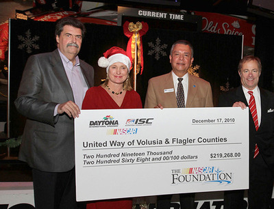 In a ceremony at the Daytona International Speedway, the 'World Center of Racing', NASCAR's President, Mike Helton, International Speedway Corporation's Chief Executive Officer, Lesa France Kennedy, and President, John Saunders (Right) presented a check today to Ray Salazar of the United Way of Volusia-Flagler Counties for $219,268.  (PRNewsFoto/International Speedway Corporation)