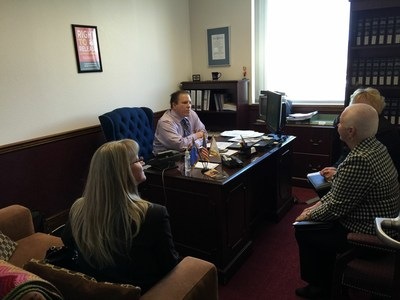 ACS CAN Nevada volunteer advocates Jennifer Nordstrom, Christy Smith and Shirley Folkins-Roberts talk to Assemblyman John Moore about the proposed $1 per pack increase in the cigarette tax.