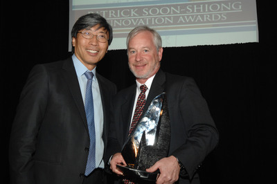 Philanthropist and biotech entrepreneur Patrick Soon-Shiong gives the Los Angeles Business Journal's 2012 Patrick Soon-Shiong Innovation Award to CODA Holdings CEO Phil Murtaugh.  (PRNewsFoto/CODA Holdings)