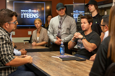 Taco Bell Foundation for Teens ambassador Mark Wahlberg shares his high school graduation story with Taco Bell employee online high school scholarship recipients at its Irvine, Calif. headquarters on Sept. 16, 2013.  (PRNewsFoto/Taco Bell Corp.)