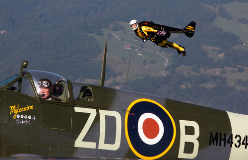 "Yves ""Jetman"" Rossy took to the skies with fellow ""Breitling Flyer"" pilot, Nigel Lamb in the renowned Spitfire MH434, Bex, Switzerland, September 7, 2012. Photo by Marie Schenk.  (PRNewsFoto/Breitling, Marie Schenk)"
