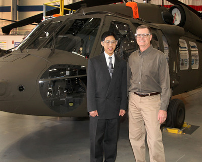 Indiana teen wins Igor Sikorsky Youth Innovator Award for his conceptual design of a circular-shaped environmentally friendly helicopter. Ethan Chu, 16, toured the BLACK HAWK helicopter production line Dec. 13 with Sikorsky Chief Test Engineer Vern Van Fleet.  (PRNewsFoto/Sikorsky Aircraft Corp.)