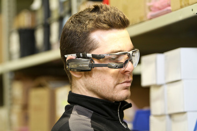 Vuzix M100 Smart Glasses being used in a warehouse for hands free communication and information access.  (PRNewsFoto/Vuzix Corporation)