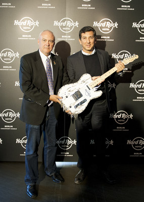 Hard Rock International Chief Executive Officer Hamish Dodds presents custom guitar to Heskel Nathaniel, founder of Trockland Development Group that in collaboration with Hard Rock will develop the future Hard Rock Hotel Berlin Checkpoint Charlie.