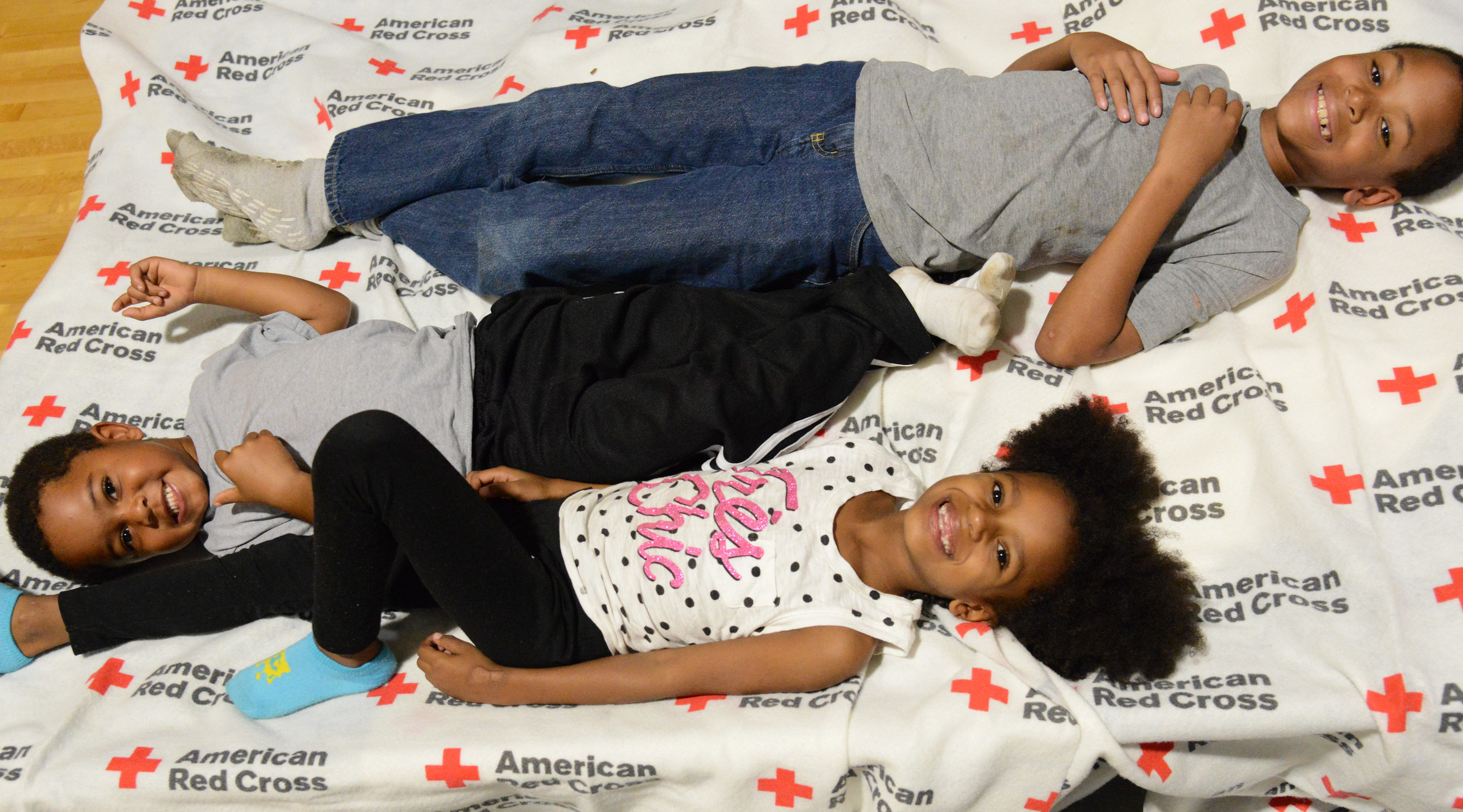 Hurricane Matthew: October 13, 2016. Kinston, North Carolina - (The Red Cross shelter at Kinston High School) - While their families focused on getting their belongings in order, the children at the Kinston High School shelter put their energy into building a tent out of cots and blankets.