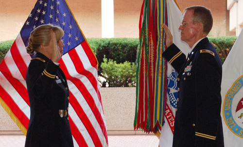 Dr. Frederick Lough, right, a cardiothoracic surgeon, takes the Oath of Office during a ceremony at the Uniformed Services University of the Health Sciences in Bethesda, Md. on 9/11/2013. Col. Karrie Fristoe, commander of the Army Medical Recruiting Brigade, officiates. Photo credit: Official U.S. Army photo by Denise Susnir(PRNewsFoto/U.S. Army Medical Recruiting Brigade)