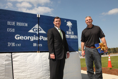 Jim Hannan, CEO and president of Georgia-Pacific, and Bryan Stirling, chief of staff to Governor Nikki Haley, celebrated the start-up of production at the company's oriented strand board (OSB) plant in Clarendon County, S.C., and 130 new jobs the operations created.  (PRNewsFoto/Georgia-Pacific)
