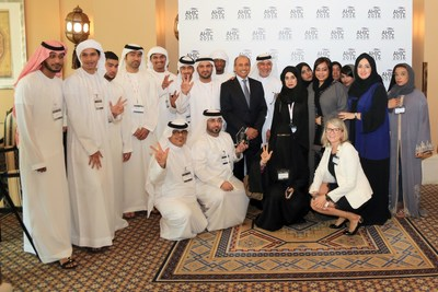 Center:  HE Tayeb Al Rais and Ahmed Ramdan, surrounded by the Minors and parents as well as AMAF staff and Fabienne Rollandin from Glion School of Hospitality. (PRNewsFoto/Roya International)