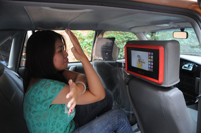The Passenger follows the in-Taxi workout instructor of Mr. and Miss WOW Campaign promoted on Touchmedia's interactive Touchscreen to do exercise for health (PRNewsFoto/Touchmedia)