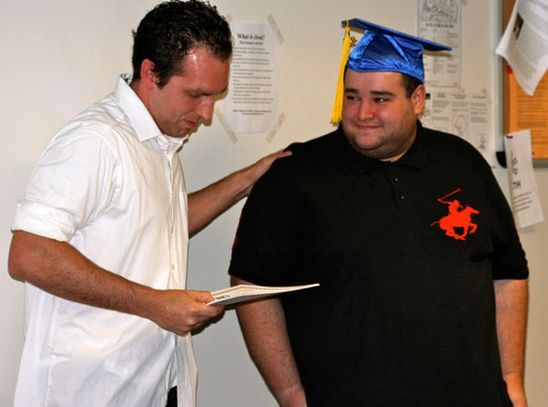 CLE graduate Josh Boin receives certificate from David Torrente, CLE tutor and advisor.  (PRNewsFoto/College Living Experience)