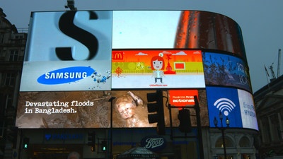 This is the first ever disruptive rain-triggered advert using donated ad space, which will interrupt Storm's One Piccadilly screen in Piccadilly Circus for a week from the 24th November appearing every time it rains. (PRNewsFoto/ActionAid)