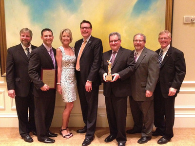 Upsher-Smith DIANA Award Presentation Attendees. Left to Right: Doug Zitnak (Sr. National Account Manager), Brad Leonard (Associate Director, National Accounts), JoAnn Gaio (National Account Manager), Mike McBride (Associate VP, Partner Relations), Mike Muzetras (Sr. National Account Manager), Dave Zitnak (Sr. National Account Manager), Jim Maahs (Sr. Director, Sales).  (PRNewsFoto/Upsher-Smith Laboratories, Inc.)