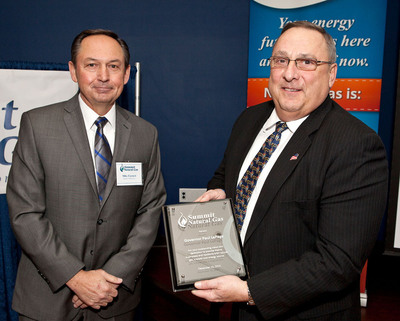 Michael Earnest, president and CEO of Summit Natural Gas of Maine's parent company Summit Utilities, Inc. presented Maine Governor Paul LePage, with a plaque to honor his vision to help Maine residents and businesses lower their heating costs. (PRNewsFoto/Summit Natural Gas of Maine) (PRNewsFoto/SUMMIT NATURAL GAS OF MAINE)