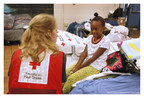 """The American Red Cross responds to nearly 70,000 disasters annually, providing emergency shelter, food, relief and comfort supplies to those affected, such as this young girl who was helped during the Red Cross response to flooding in South Carolina this past fall. Visit the American Red Cross Holiday Gift Catalog (redcross.org/gifts) and learn how to give something that means something this holiday season; for example, making a $50 donation """"buys"""" a Full Day of Emergency Shelter-that includes three meals plus snacks, a cot, two blankets and hygiene supplies-for someone who may have lost everything to a disaster. [Photo taken October 9, 2015, in Columbia, South Carolina, shelter by Danuta Otfinowski/American Red Cross]"""
