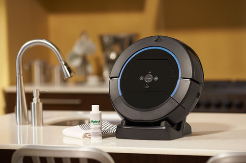 The iRobot(R) Scooba(R) 450 is the only hard floor-scrubbing robot on the market, using the Scooba Three-Cycle Cleaning Process to maintain constantly clean floors and wash away up to 99.3% of bacteria.*(PRNewsFoto/iRobot Corp.)