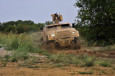 A Lockheed Martin Joint Light Tactical Vehicle undergoes testing at the company's Dallas test track. Lockheed Martin JLTVs have completed more than 100,000 miles of testing during the program's current development phase, and more than 250,000 total miles.