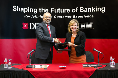 In Singapore, Piyush Gupta, Chief Executive Officer, DBS Group Holdings & DBS Bank (left) and Bridget van Kralingen, Senior Vice President, IBM Global Business Services (right) sign an agreement for DBS to deploy IBM's Watson cognitive computing innovation to deliver a next- generation client experience.  (PRNewsFoto/IBM)