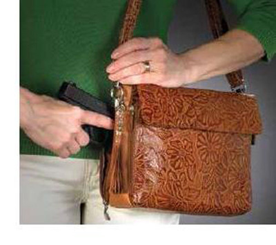 Tooled American Cowhide.  (PRNewsFoto/Pistolpacknmama.com)
