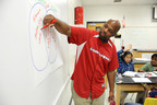 Georgia Power Energy Efficiency Education Coordinator Cedric Sheffield works with students in the classroom during a recent Learning Power summer camp.