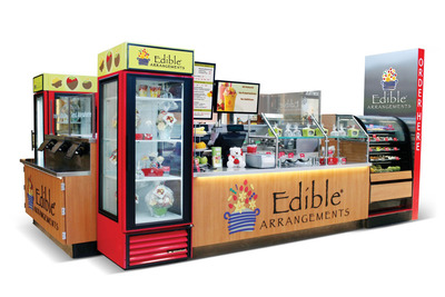 Edible Arrangements(R) is making it easier than ever for guests to enjoy their fresh fruit treats with the launch all new Edible To Go(R) Locations designed for shopping malls and other high-traffic venues. Two years in development, the new Edible To Go(R) Locations are a fruit lover's dream.  The streamlined mall units are decorated with colorful, contemporary graphics and offer a tantalizing array of fresh cut, all-natural fruits, smoothies, fresh squeezed lemonade and orange juice, fresh fruit salads, sundaes and parfaits, as well as fresh fruit arrangements.  (PRNewsFoto/Edible Arrangements)