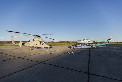 The unmanned K-MAX (left) and the optionally-piloted Sikorsky Autonomy Research Aircraft (SARA) (right) participated in a collaborative firefighting demonstration with the Indago (front left) and Desert Hawk 3.1 (front right). Photo courtesy Lockheed Martin.