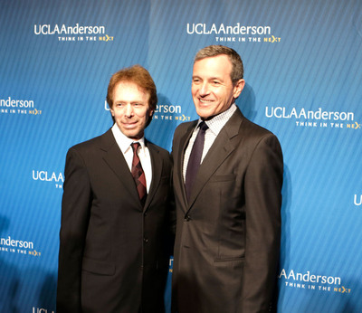 Film and TV producer Jerry Bruckheimer with The Walt Disney Company Chairman and CEO Robert A. Iger at the 2013 John Wooden Global Leadership Award dinner.  (PRNewsFoto/UCLA Anderson School of Management)
