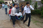 Nepal earthquake victims rushed to medical centers.  Save the Children response teams are on the ground.