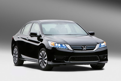 The Ohio-built 2014 Honda Accord Hybrid goes on sale nationwide this October, and will offer class-leading fuel economy.  (PRNewsFoto/American Honda Motor Co., Inc.)