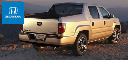 The sport-ready 2013 Honda Ridgeline provides the utility of a pickup with classic Honda driveability.  (PRNewsFoto/Spreen Honda)