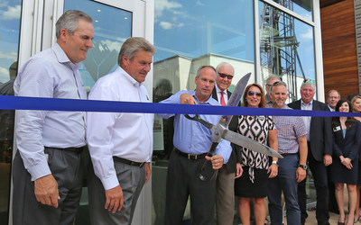 Vista Outdoor CEO Mark DeYoung cuts the ribbon on the company's new corporate headquarters in Farmington, Utah
