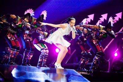 Opening scene of the Prismatic World Tour featuring Katy Perry and backing dancers wearing Stratasys 3D printed mohawks. Photography by Jason Williamson.
