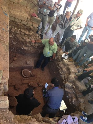 Archaeologists and media gathered at the newly discovered burial site in Copan.