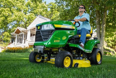 The John Deere X330 Select Series Tractor Mower offers more horsepower while maintaining a clean cut.
