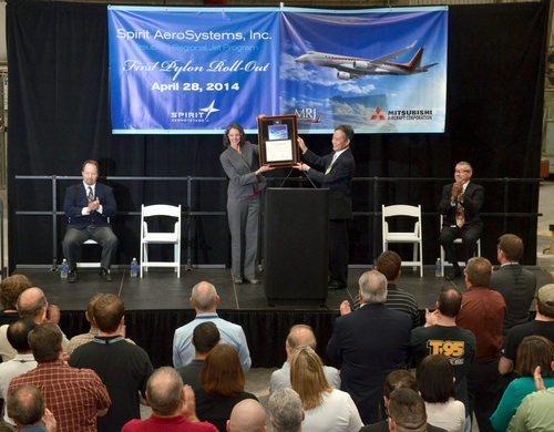 Vice President of Supply Chain for Mitsubishi Aircraft, Fujimori-san, presents a plaque to Spirit AeroSystems Director of Business & Regional Jet programs, Cathy McClain at a celebration marking the delivery of the first test flight pylon for the Mitsubishi Regional Jet. (PRNewsFoto/Spirit AeroSystems, Inc.) (PRNewsFoto/Spirit AeroSystems, Inc.)
