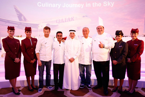 Pictured following a press conference in Doha announcing Qatar Airways' new line-up of culinary ambassadors flanked by airline cabin crew are, from left: Chef Tom Aikens, Chef Vineet Bhatia, Qatar Airways CEO Akbar Al Baker, Chef Nobu Matsuhisa and Chef Ramzi Choueiri.  (PRNewsFoto/Qatar Airways)