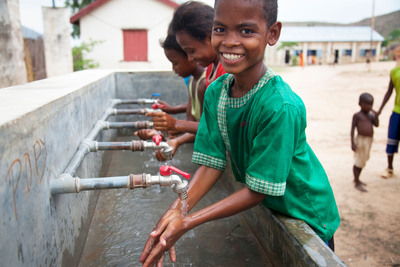 Julien, 12, washes his hands in clean water from newly installed taps at Ampanasana primary school in Miandrivazo, Madagascar.  (PRNewsFoto/WaterAid)