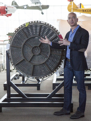 Jeff Bezos showing Apollo 12's F-1 rocket engine injector plate at unveiling ceremony at The Museum of Flight in Seattle. Credit Ted Huetter/The Museum of Flight