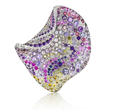 "The Pink Petal Brooch, by Naomi Sarna, to receive the ""Gem Diva"" AGTA Spectrum Award at GemFair Tucson 2016. The piece features white, green, yellow, and pink diamonds with multicolored sapphires and amethysts set in 18K palladium white gold (537 stones total). 44 mm x 40 mm x 14 mm."