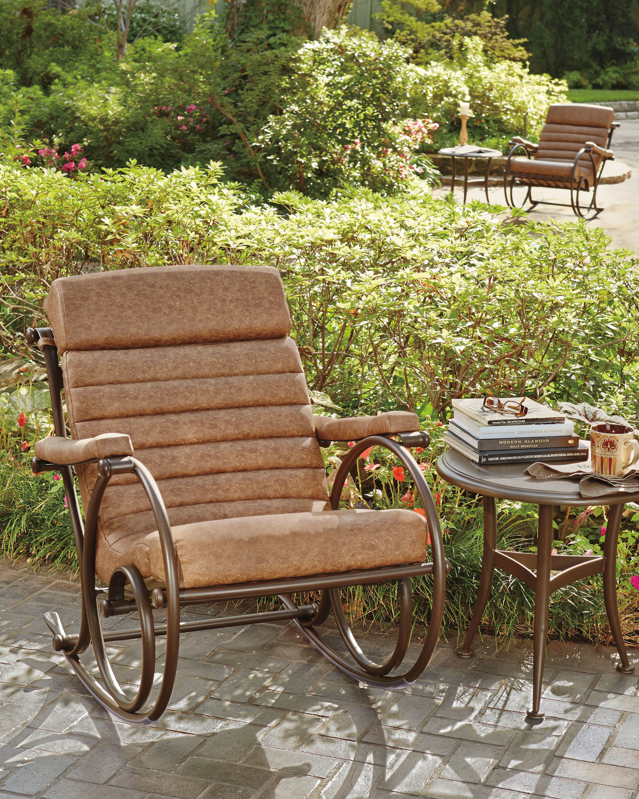 Woodard Anniversary Rocker in brown makes a handsome addition to backyards.