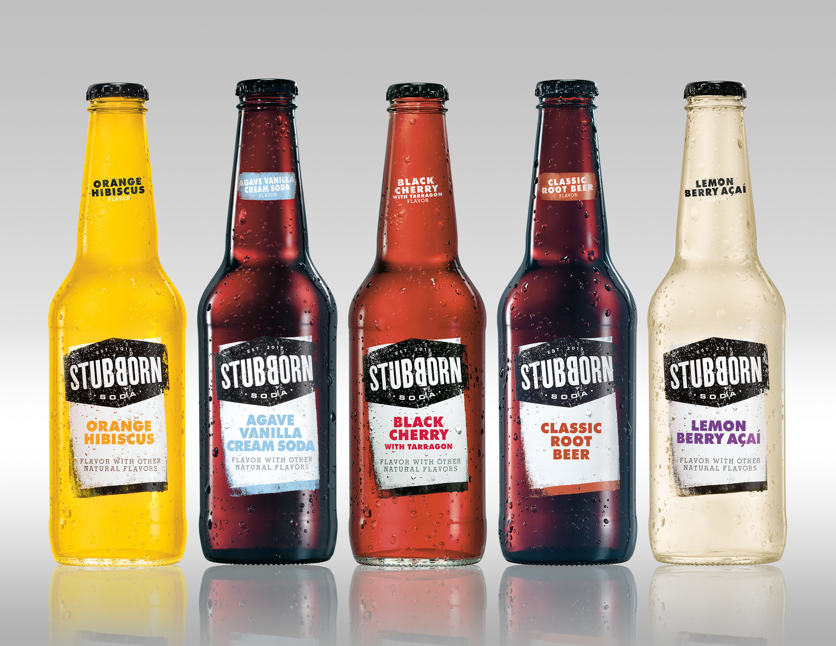 Stubborn Soda bottle line-up with garnishes