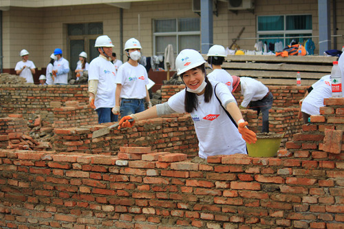 For 30 years, Dow employees have built in partnership with Habitat for Humanity around the world, including China in 2012.  (PRNewsFoto/Habitat for Humanity International)
